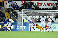 Esteban Cambiasso of Leicester city (19) fails to score from close range as Swansea goalkeeper Lukasz Fabianski manages to save. Barclays Premier league match, Swansea city v Leicester city at the Liberty stadium in Swansea, South Wales on Saturday 25th October 2014<br /> pic by Andrew Orchard, Andrew Orchard sports photography.