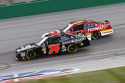 July 13, 2018 - Sparta, Kentucky, United States of America - Mike Harmon (74) and Michael Annett (5) battle for position during the Alsco 300 at Kentucky Speedway in Sparta, Kentucky. (Credit Image: © Chris Owens Asp Inc/ASP via ZUMA Wire)