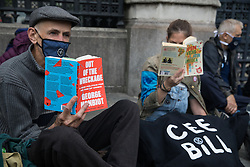 London, UK. 3rd September, 2020. Climate activists from Extinction Rebellion, some of whom glued to the pavement, read books as they blockade the Houses of Parliament. Extinction Rebellion activists are attending a series of September Rebellion protests around the UK to call on politicians to back the Climate and Ecological Emergency Bill (CEE Bill) which requires, among other measures, a serious plan to deal with the UK's share of emissions and to halt critical rises in global temperatures and for ordinary people to be involved in future environmental planning by means of a Citizens' Assembly.