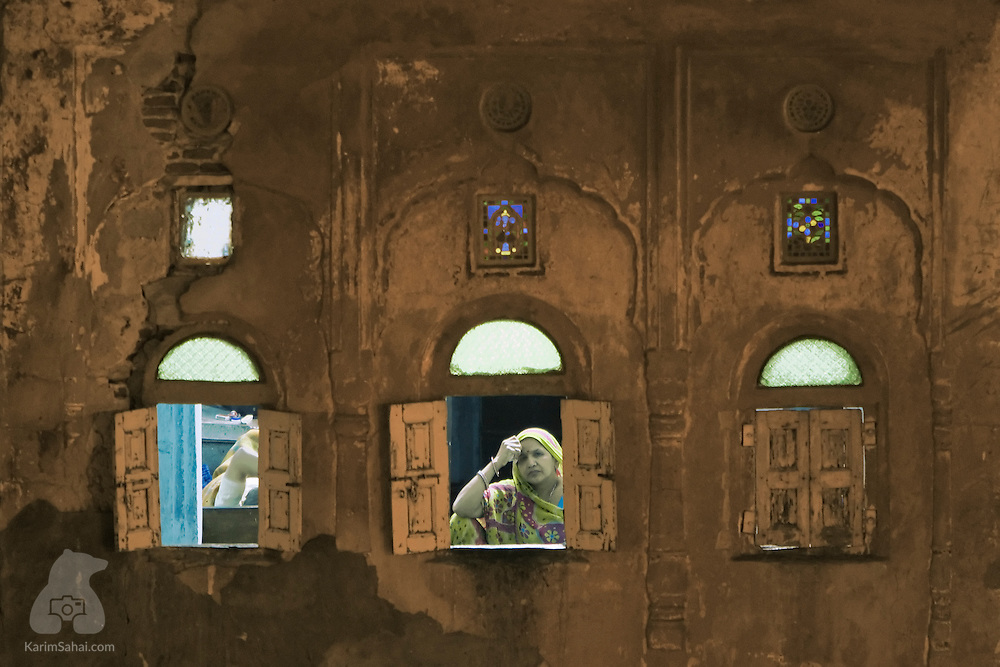 Woman sitting by a window, Jaipur, Rajasthan, India.
