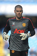 Goalkeeper Victor Valdes of Manchester United during pre-match warm up. Barclays Premier league match, Chelsea v Manchester Utd at Stamford Bridge Stadium in London on Saturday 18th April 2015.<br /> pic by John Patrick Fletcher, Andrew Orchard sports photography.