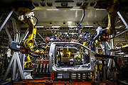 A Ford Super Duty frame makes its way down the assembly line.