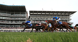 Koditime (left) ridden by jockey Ryan Moore goes on to win the Yorkshire Equine Practice Handicap during day three of the 2018 Dante Festival at York Racecourse.