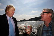 London, UK. Monday 8th September 2014. London Mayor Boris Johnson travelling down the Thames on the Silver Darling with Adrian Evans, Director of Totally Thames, after a visit to Royal Greenwich Tall Ships Festival which is organized by RB Greenwich. The Festival is included as a highlight of Totally Thames, the new month-long promotion of river and riverside events delivered by Thames Festival Trust.