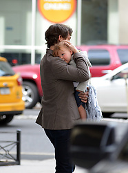 April 25, 2014 - New York City, NY, USA - Actor Hugh Dancy carries his son Cyrus in Soho on April 25 2014 in New York City  (Credit Image: © Curtis Means/Ace Pictures/ZUMAPRESS.com)