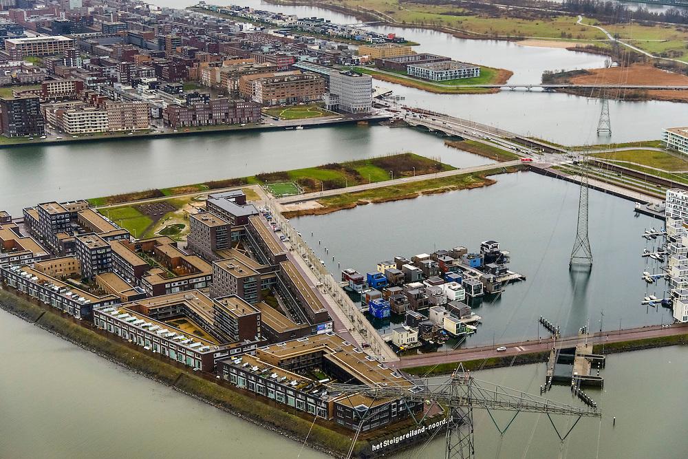 Nederland, Noord-Holland, Amsterdam, 16-01-2014;<br /> IJburg met Steigereiland ( r) en een hoogspanningsmast die volgens sommigen ziektes veroorzaakt door het elektromagnetische veld (EMV) .<br /> New residential area IJburg, floating houses of Steigereiland.<br /> luchtfoto (toeslag op standard tarieven);<br /> aerial photo (additional fee required);<br /> copyright foto/photo Siebe Swart