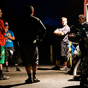 Riders congregate after a night of downhill mountain biking at the Stagecoach Bar in Wilson, Wyoming.