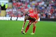 Gareth Bale of Wales wipes his boots.  Euro 2016 qualifying match, Wales v Israel at the Cardiff city stadium in Cardiff, South Wales on Sunday 6th Sept 2015.  pic by Andrew Orchard, Andrew Orchard sports photography.