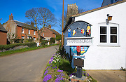 Village sign and houses, Happisburgh, Norfolk, England
