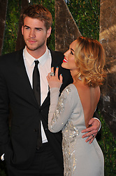 Liam Hemsworth and Miley Cyrus attending the 2012 Vanity Fair Oscar Party held at the Sunset Towers Hotel, West Hollywood, Los Angeles, CA, USA on February 26, 2012. Photo by VF/ABACAPRESS.COM