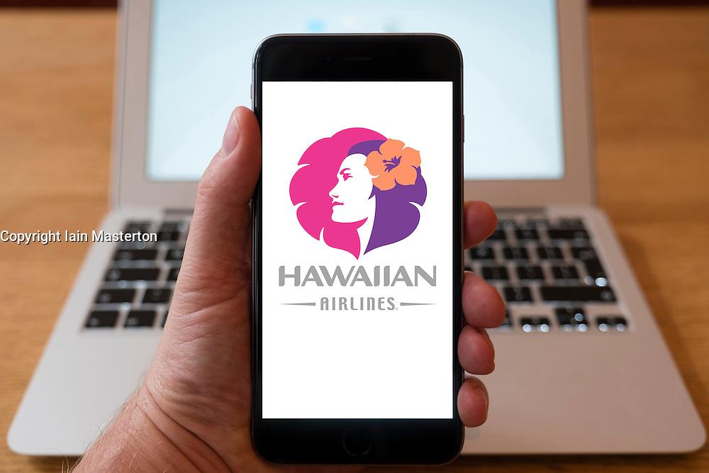 Using iPhone smartphone to display logo of Hawaiian Airlines