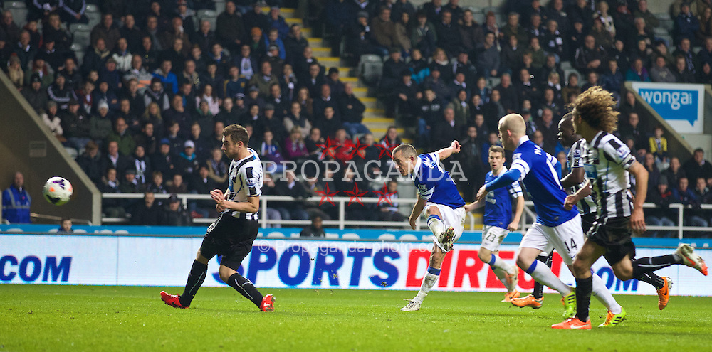 NEWCASTLE-UPON-TYNE, ENGLAND - Tuesday, March 25, 2014: Everton's Leon Osman scores the third goal against Newcastle United during the Premiership match at St. James' Park. (Pic by David Rawcliffe/Propaganda)