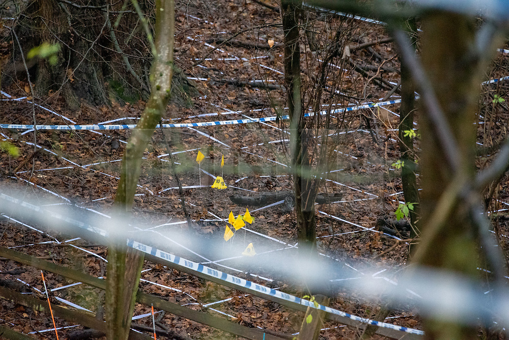 © Licensed to London News Pictures. 12/12/2019. Gerrards Cross, UK. Police tape and evidence identification markers on woodland floor at the site of a search operation as the Metropolitan Police Service confirm they are searching woodland in Beaconsfield, Buckinghamshire in connection with the disappearance and murder of Mohammed 'Shah' Subhani. Police have been in the area conducting operations on Hedgerley Lane since Thursday 5th December 2019 and are combing wooded area with specialist officers, assisted by specialist search dogs. Photo credit: Peter Manning/LNP