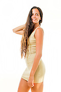Young confident woman in her 20s with long brown hair in casual dress. Model release available