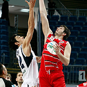Efes Pilsen's Kerem GONLUM (L) and Pinar Karsiyaka's Furkan ALDEMIR (R) during their Turkish Basketball Legague Play-Off qualifying first match Efes Pilsen between Pinar Karsiyaka at the Sinan Erdem Arena in Istanbul Turkey on Wednesday 11 May 2011. Photo by TURKPIX