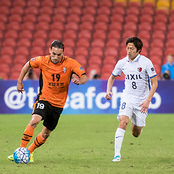 BRISBANE, AUSTRALIA - APRIL 12: Jack Hingert of the Roar dribbles the ball under pressure from Doi Shouma of Kashima during the Asian Champions League Group Stage match between the Brisbane Roar and Kashima Antlers at Suncorp Stadium on April 12, 2017 in Brisbane, Australia. (Photo by Patrick Kearney/Brisbane Roar)