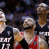 06 March 2011: Chicago Bulls power forward Carlos Boozer (5) vies for a rebound with Miami Heat shooting guard Mike Miller (13) and Miami Heat power forward Chris Bosh (1) during the Chicago Bulls 87-86 victory over the Miami Heat at the AmericanAirlines Arena, Miami, Florida, USA.