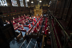 Queen Elizabeth II, accompanied by the Prince of Wales, in the House of Lords at the Palace of Westminster in London during the State Opening of Parliament. Picture date: Tuesday May 11, 2021.