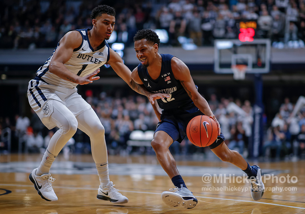 INDIANAPOLIS, IN - FEBRUARY 15: Terrell Allen #12 of the Georgetown Hoyas dribbles the ball against Jordan Tucker #1 of the Butler Bulldogs at Hinkle Fieldhouse on February 15, 2020 in Indianapolis, Indiana. (Photo by Michael Hickey/Getty Images) *** Local Caption *** Terrell Allen; Jordan Tucker