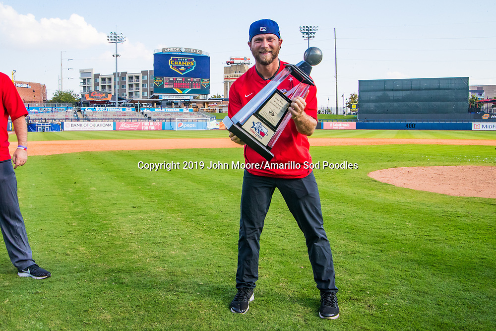 Drew Garner poses with the trophy after the Sod Poodles won against the Tulsa Drillers during the Texas League Championship on Sunday, Sept. 15, 2019, at OneOK Field in Tulsa, Oklahoma. [Photo by John Moore/Amarillo Sod Poodles]