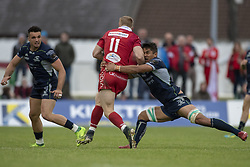 September 22, 2018 - Galway, Ireland - Johnny McNicholl of Scarlets tackled by Jarrad Butler of Connacht during the Guinness PRO14 match between Connacht Rugby and Scarlets at the Sportsground in Galway, Ireland on September 22, 2018  (Credit Image: © Andrew Surma/NurPhoto/ZUMA Press)