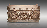 """Picture of Roman relief sculpted Sarcophagus of Garlands, 2nd century AD, Perge. This type of sarcophagus is described as a """"Pamphylia Type Sarcophagus"""". It is known that these sarcophagi garlanded tombs originated in Perge and manufactured in the sculptural workshops of Perge. Antalya Archaeology Museum, Turkey.. Against a grey background..<br /> <br /> If you prefer to buy from our ALAMY STOCK LIBRARY page at https://www.alamy.com/portfolio/paul-williams-funkystock/greco-roman-sculptures.html . Type -    Antalya    - into LOWER SEARCH WITHIN GALLERY box - Refine search by adding a subject, place, background colour, etc.<br /> <br /> Visit our ROMAN WORLD PHOTO COLLECTIONS for more photos to download or buy as wall art prints https://funkystock.photoshelter.com/gallery-collection/The-Romans-Art-Artefacts-Antiquities-Historic-Sites-Pictures-Images/C0000r2uLJJo9_s0"""