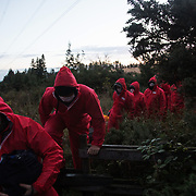 Nee More Coal action in the Pont Valley. Climate activists dressed in red entered the Banks Group open cast coal mine Bradley site in Pont Valley early morning. The site was not operating and stayed closed for the day. The action was part of a peaceful mass demonstration by local actvists and climate protectors.