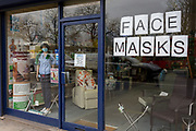 As the Coronovirus pandemic takes hold across the UK, with 53 cases now reported by health authorities, the window of a medical equipment business in south London, displays a face masks sign and a surgical masks worn by a nurse's mannequin, on 4th March 2020, in London, England.