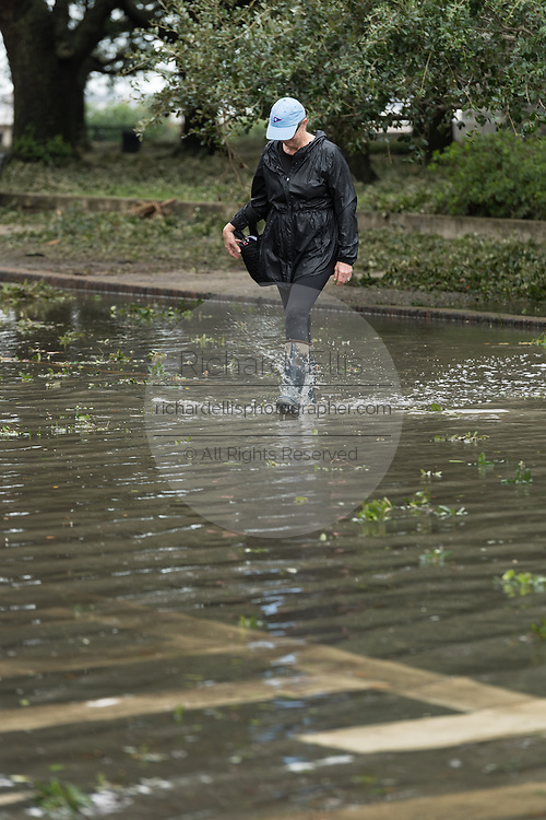 A resident crosses flood water along South Battery Street in historic downtown after Hurricane Matthew passed through causing flooding and light damage to the area October 8, 2016 in Charleston, South Carolina. The hurricane made landfall near Charleston as a Category 2 storm but quickly diminished as it moved north.