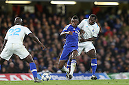 Ramires of Chelsea holds off Vincent Aboubakar of FC Porto. UEFA Champions league group G match, Chelsea v Porto at Stamford Bridge in London on Wednesday 9th December 2015.<br /> pic by John Patrick Fletcher, Andrew Orchard sports photography.
