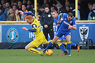 AFC Wimbledon defender Barry Fuller (2) tackling Oxford United striker Ryan Taylor (20) during the EFL Sky Bet League 1 match between AFC Wimbledon and Oxford United at the Cherry Red Records Stadium, Kingston, England on 14 January 2017. Photo by Matthew Redman.