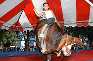 Gilberto Ramirez, 7, of Antioch rides a mechanical bull at the Contra Costa County Fair in Antioch on Sunday, June 3, 2012.  (Photo by Kevin Bartram)