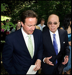 Prime Minister David Cameron pictured talking to News Corp Chairman Rupert Murdoch at the wedding of Rebecca Wade to Charlie Brooks in June 2009. Photo By Julian Andrews/i-Images..25/04/12. Pics © Copyright Julian Andrews 2012...NOTE TO DESK...PERMISSION TO USE MUST BE OBTAINED BEFORE EVERY USE OF THIS PICTURE...PICTURE HAS A MANDATORY CREDIT  AND A MINIMAL REPRODUCTION FEE OF £250 IN PRINT AND £75 ONLINE...PICTURE MUST NOT BE ARCHIVED OR USED WITHOUT PRIOR PERMISSION...