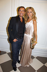 Leading stylist RACHEL ZOE and fashion designer JULIEN MACDONALD at a party to celebrate the opening of PPQ Mayfair at 47 Conduit Street, London W1 on 18th September 2006.<br />