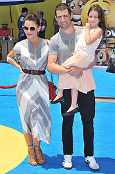 """(L-R) Tess Sanchez, Max Greenfield and daughter Lilly Greenfield arrives at """"The Emoji Movie"""" Los Angeles Premiere held at Regency Village Theatre in Westwood, CA on Sunday, July 23, 2017. (Photo By Sthanlee B. Mirador) *** Please Use Credit from Credit Field ***"""