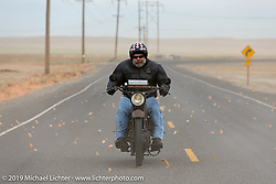 Dave Minerva Portrait riding his 1916 Harley-Davidson model F through an onion storm (those are onion skins flying everywhere) on the Motorcycle Cannonball coast to coast vintage run. Stage 14 (303 miles) from Spokane, WA to The Dalles, OR. Saturday September 22, 2018. Photography ©2018 Michael Lichter.