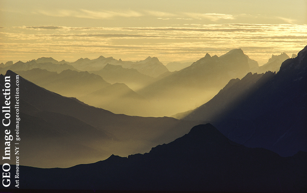 Ridges of the Alps with fog.