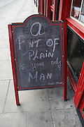 """""""A Pint of Plain Is Your Only Man"""" sign outside Dublin pub. It's a quote a poem of the same title written by Flann O'Brien, author of The Third Policeman. Outside the Millennium pub, Parkgate St. .."""