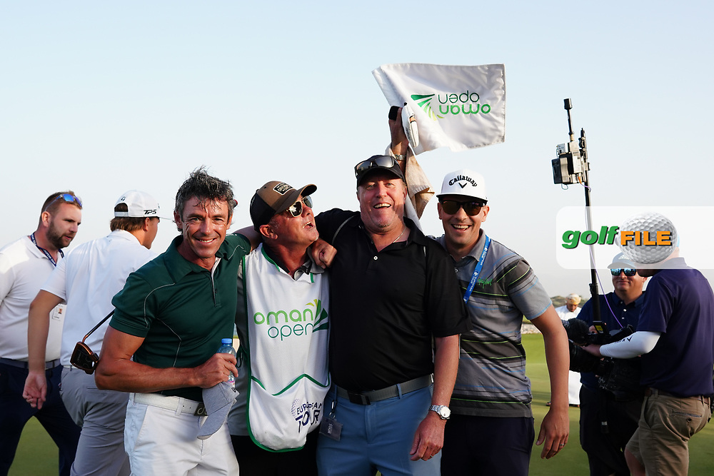 Kyle Roadley celebrates with other caddies after winning the Oman Open 2020 at the Al Mouj Golf Club, Muscat, Oman . 01/03/2020<br /> Picture: Golffile | Thos Caffrey<br /> <br /> <br /> All photo usage must carry mandatory copyright credit (© Golffile | Thos Caffrey)