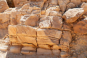 "Rock Strata closeup photographed at Makhtesh Ramon a geological feature of Israel's Negev desert. Located at the peak of Mount Negev, the world's largest ""erosion cirque"" (steephead valley or box canyons). The formation is 40 km long, 2–10 km wide and 500 meters deep, Today the area forms Israel's largest national park, the Ramon Nature Reserve."