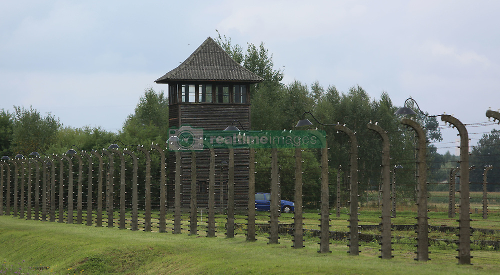 A guard tower and barbed wire fences at the Auschwitz-Birkenau Nazi concentration camps in Auschwitz, Poland on September 3, 2017. Auschwitz concentration camp was a network of German Nazi concentration camps and extermination camps built and operated by the Third Reich in Polish areas annexed by Nazi Germany during WWII. It consisted of Auschwitz I (the original camp), Auschwitz II–Birkenau (a combination concentration/extermination camp), Auschwitz II–Monowitz (a labor camp to staff an IG Farben factory), and 45 satellite camps. In September 1941, Auschwitz II–Birkenau went on to become a major site of the Nazi Final Solution to the Jewish Question. From early 1942 until late 1944, transport trains delivered Jews to the camp's gas chambers from all over German-occupied Europe, where they were killed en masse with the pesticide Zyklon B. An estimated 1.3 million people were sent to the camp, of whom at least 1.1million died. Around 90 percent of those killed were Jewish; approximately 1 in 6 Jews killed in the Holocaust died at the camp. Others deported to Auschwitz included 150,000 Poles, 23,000 Romani and Sinti, 15,000 Soviet prisoners of war, 400 Jehovah's Witnesses, and tens of thousands of others of diverse nationalities, including an unknown number of homosexuals. Many of those not killed in the gas chambers died of starvation, forced labor, infectious diseases, individual executions, and medical experiments. In 1947, Poland founded a museum on the site of Auschwitz I and II, and in 1979, it was named a UNESCO World Heritage Site. Photo by Somer/ABACAPRESS.COM