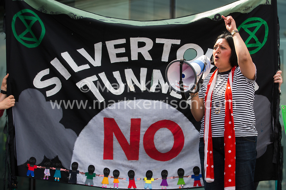 London, UK. 5th June, 2021. Rokhsana Fiaz, Mayor of Newham, addresses environmental activists and local residents protesting against the construction of the Silvertown Tunnel. Campaigners opposed to the controversial new £2bn road link across the River Thames from the Tidal Basin Roundabout in Silvertown to Greenwich Peninsula argue that it is incompatible with the UK's climate change commitments because it will attract more traffic and so also increased congestion and air pollution to London's most polluted borough.