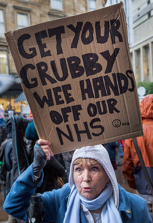Demonstration against US President Donald Trump on Buchanan Street, Glasgow. <br /> <br /> Picture Robert Perry 4th June 2019<br /> <br /> Must credit photo to Robert Perry<br /> FEE PAYABLE FOR REPRO USE<br /> FEE PAYABLE FOR ALL INTERNET USE<br /> www.robertperry.co.uk<br /> NB -This image is not to be distributed without the prior consent of the copyright holder.<br /> in using this image you agree to abide by terms and conditions as stated in this caption.<br /> All monies payable to Robert Perry<br /> <br /> (PLEASE DO NOT REMOVE THIS CAPTION)<br /> This image is intended for Editorial use (e.g. news). Any commercial or promotional use requires additional clearance. <br /> Copyright 2018 All rights protected.<br /> first use only<br /> contact details<br /> Robert Perry     <br /> <br /> no internet usage without prior consent.         <br /> Robert Perry reserves the right to pursue unauthorised use of this image . If you violate my intellectual property you may be liable for  damages, loss of income, and profits you derive from the use of this image.