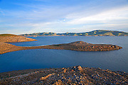 The San Luis Dam and San Luis Reservoir is a water-storage reservoir in the Diablo Mountains. It is part of the California State Water Project and Central Valley Project storing water taken from the San Joaquin-Sacramento River Delta for use down state for agricultural irrigation and the water supply for Los Angeles. Merced County, California, USA