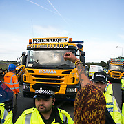 13 local activists locked themselves in specially made arm tubes to block the entrance to Quadrilla's drill site in New Preston Road, July 03 2017, Lancashire, United Kingdom. Pete Marquis and his men demolish a tower erected by activists. Pete Marquis, a pro-fracker and highly controversial local entrepeneur who owns a hauling company.The 13 activists included 3 councillors; Julie Brickles, Miranda Cox and Gina Dowding and Nick Danby, Martin Porter, Jeanette Porter,  Michelle Martin, Louise Robinson,<br />