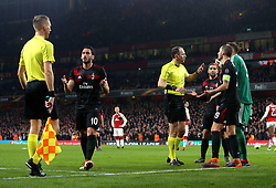 AC Milan players surround the officials after a penalty is awarded against them - Mandatory by-line: Robbie Stephenson/JMP - 15/03/2018 - FOOTBALL - Emirates Stadium - London, England - Arsenal v AC Milan - UEFA Europa League Round of 16, Second leg