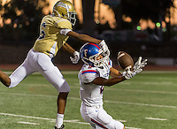 Folsom Bulldogs Drake Stallworth (2), catches the ball as Burbank High School Titans Jaylen Hollis (6), defends as the Burbank Titans host the Folsom Bulldogs, Friday, September 18, 2015.<br /> Brian Baer/Special to the Bee