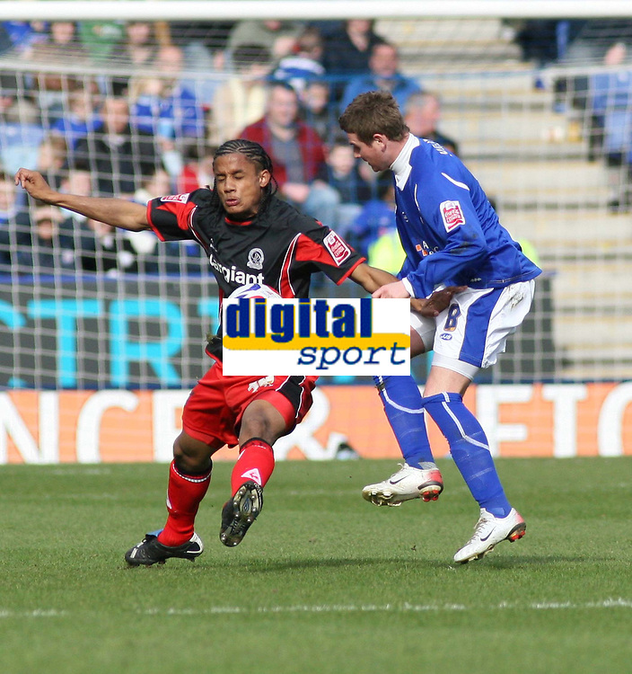 Photo: Mark Stephenson.<br />Leicester City v Queens Park Rangers. Coca Cola Championship. 17/03/2007. QPR's Michael Mancienne holds off Leicester's Mark Yates