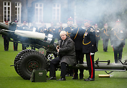 © London News Pictures. 05/11/2013 . London, UK.  Mayor of London BORIS JOHNSON, joined by members of the Armed Forces, helps fire a gun salute to launch London Poppy Day at The Honourable Artillery Company in London. The Mayor fired a salute from a 105mm light gun to launch this year's campaign, which aims to raise more than £1million in just one day. Photo credit : Ben Cawthra/LNP