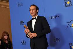 """Composer Alexandre Desplat poses with the Best Original Score - Motion Picture award for 'The Shape of Water' during NBC's """"75th Annual Golden Globe Awards"""" press room held at the Beverly Hilton Hotel on January 07, 2018 in Beverly Hills, CA, USA (Photo by Carlos Amaya/Sipa USA)"""
